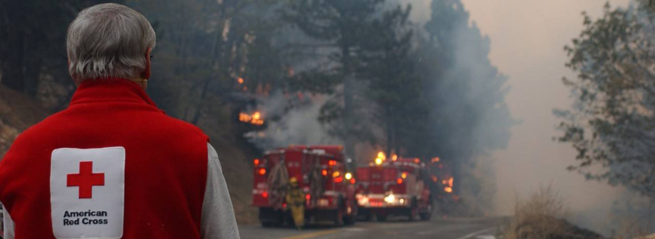 volunteer watching fire fighters battle wildfire
