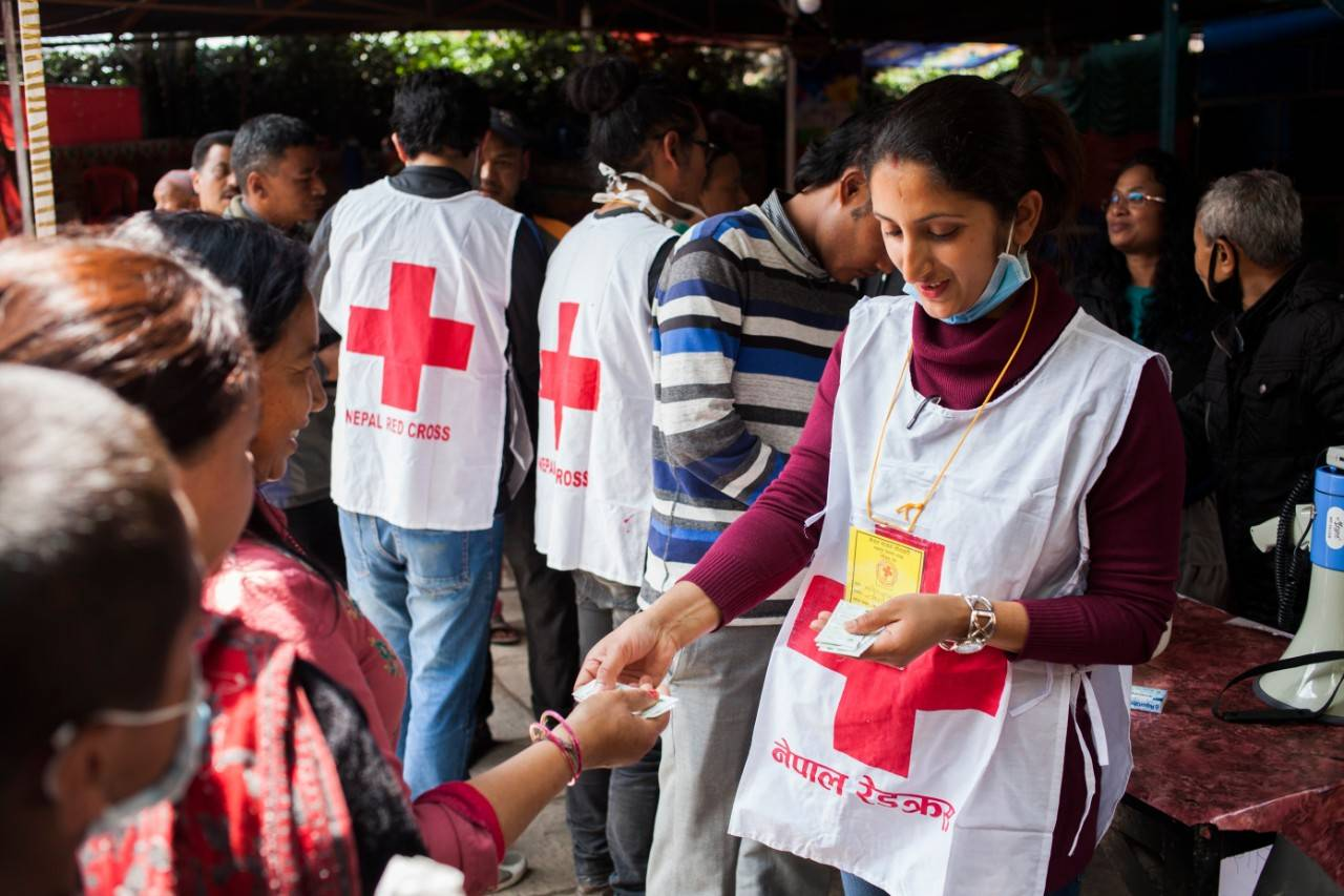 Nepal Redcross volunteer, Manisha Bashyal, 25 yrs distributing water purification tablets Aquatab to the locals living temporarily at camp of Bhaktapur districts, Nepal on Thrusday 30th April, 2015.