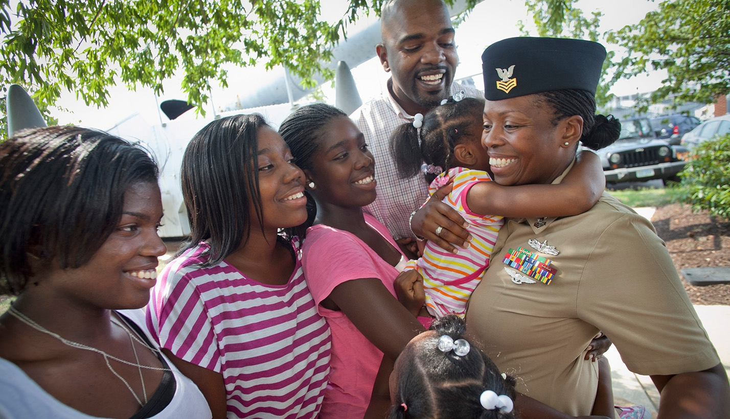 female military member with family