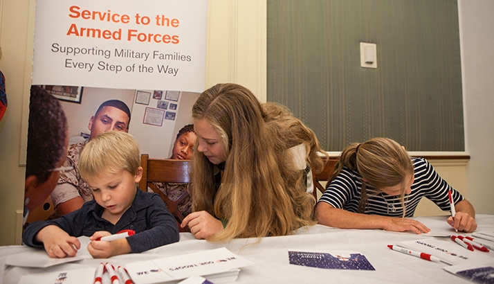 children fill out cards for the military