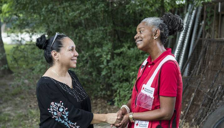 Cheryl Burton, a volunteer with the American Red Cross, speaks with Maria Rutila Acevedo.