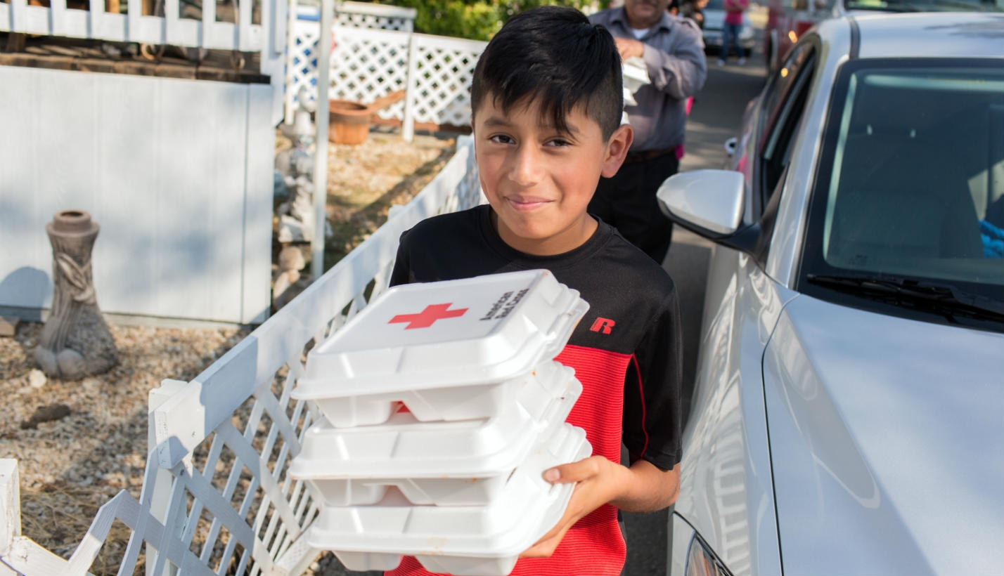Volunteer serves meal from emergency response vehicle