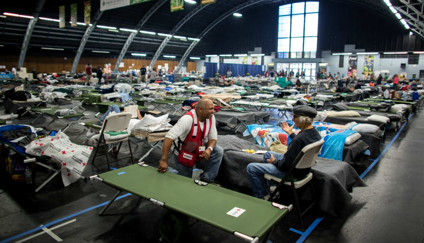 People seek shelter from wildfires