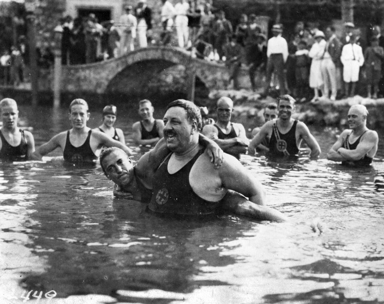 Commodore Wilbert E. Longfellow teaching a swimming class.