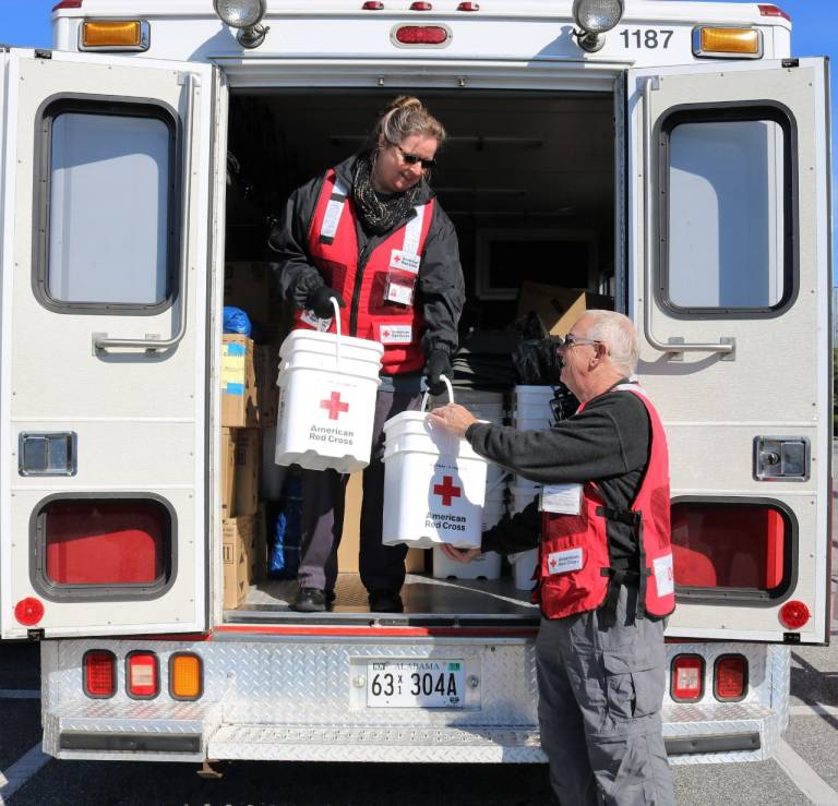 Volunteers Peter Simmons and Jane Jenkins distribute relief supplies in Alabama. Red Cross photo by Ashley Henyan