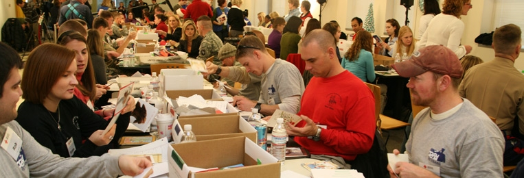 People making Holiday Mail for Heroes cards