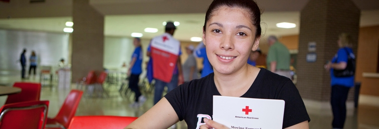 Teen girl in a Red Cross Shelter