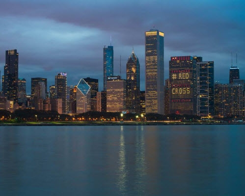 Chicago Skyline buildings spell out Red Cross in their lights