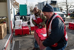 Red Cross volunteers load trucks with supplies for Superstorm Sandy victims