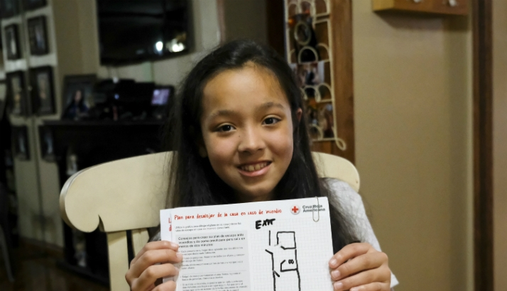 Girl holds up a home fire escape plan that she worked on