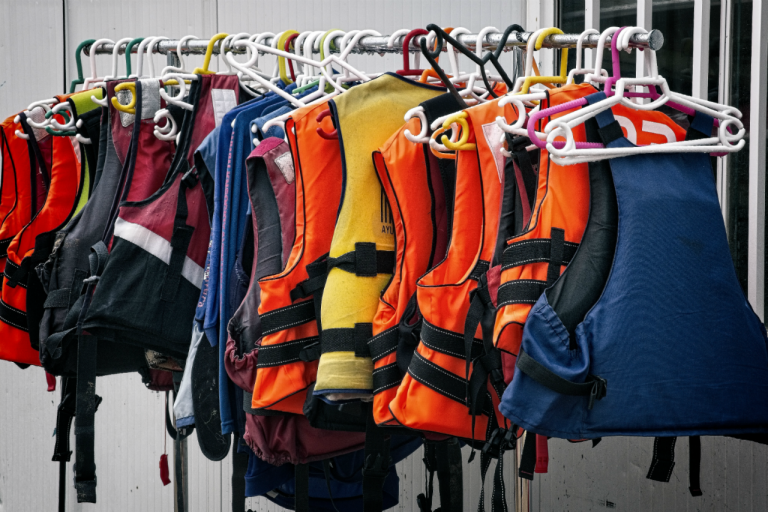 Variety of life jackets hanging up