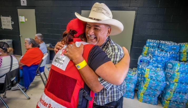 Red Cross volunteer and Francisco Vallejo embrace.