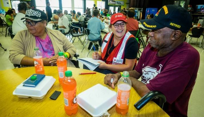 Ruth Johnson and Creston Callis, a US Army Veteran, speak with a Red Cross worker