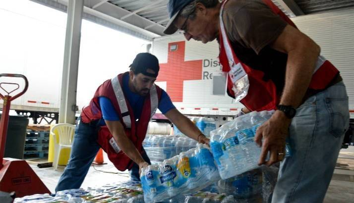 Hurricane Harvey - Volunteers unload water from a truck