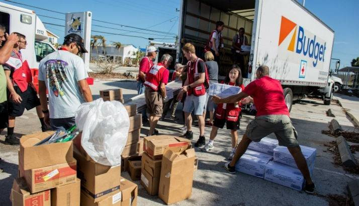 Volunteers loading meals to the truck