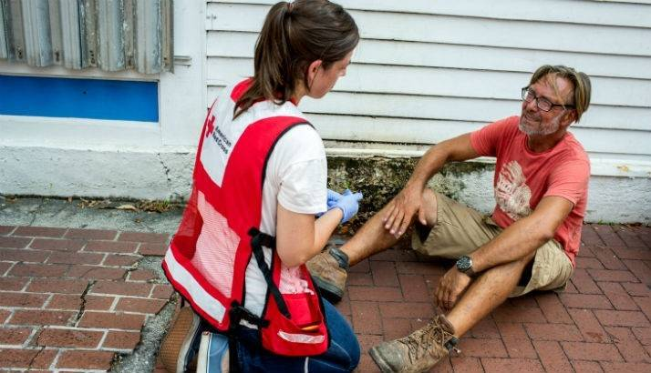 Michael receives disaster health services from Red Cross volunteer nurse Kelly Suter, Key West, Florida.