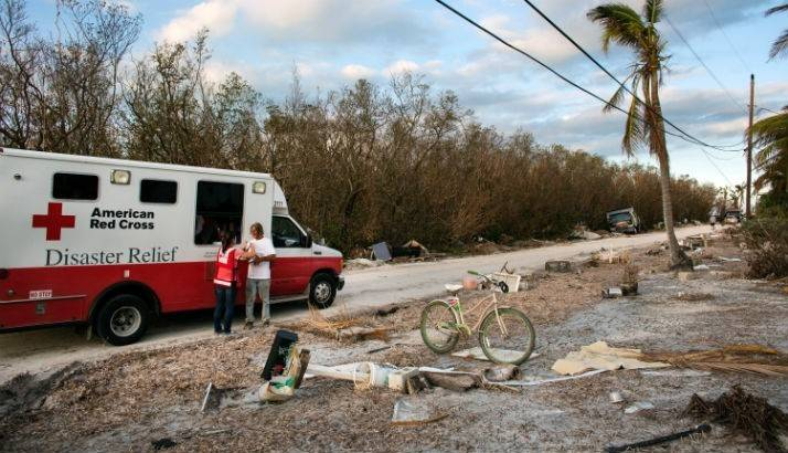 Red Cross volunteer Kelly speaks with a Hurricane Irma survivor during Red Cross hot meal delivery in Marathon, Florida.