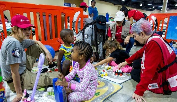 Kids play in an emergency shelter