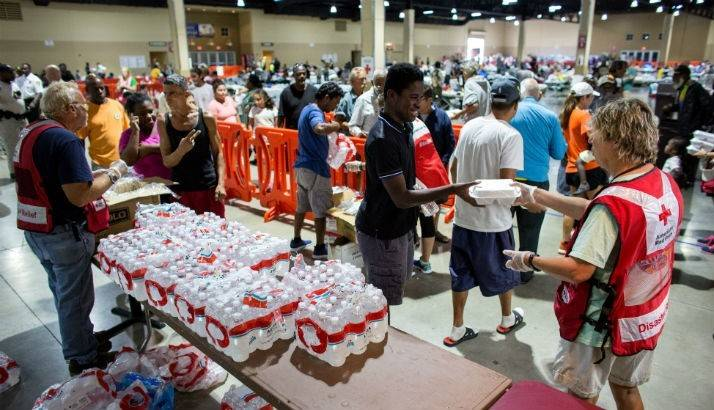 Volunteers hand out meals