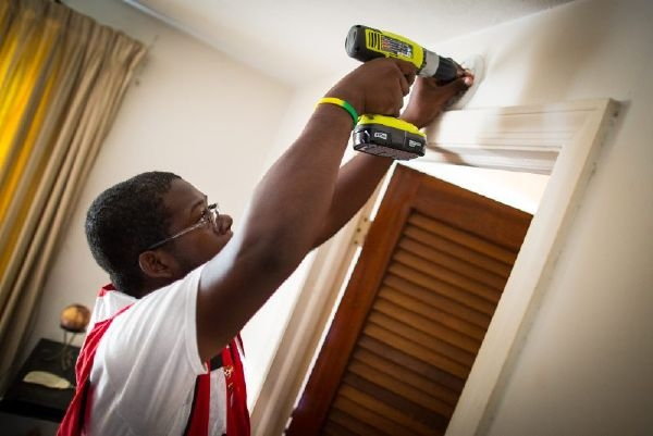 Man Installing Smoke Alarm For The Red Cross
