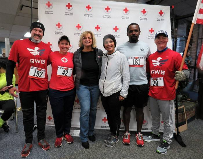 Runners pose for a picture prior to the start of the New Jersey Red Cross Run for the Red Race