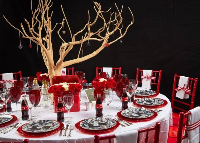 Metro New York North Red Cross Ball table set for dinner with red and white linens.