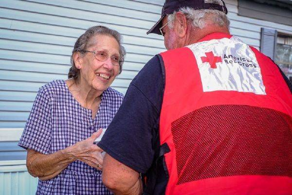 September 3, 2017. Victoria, Texas. Red Cross volunteer Ted Mueller of Norwood, Colorado, brings hot meals to Mabel Gaines. Mabel said,  The Red Cross is wonderful. God bless you.   