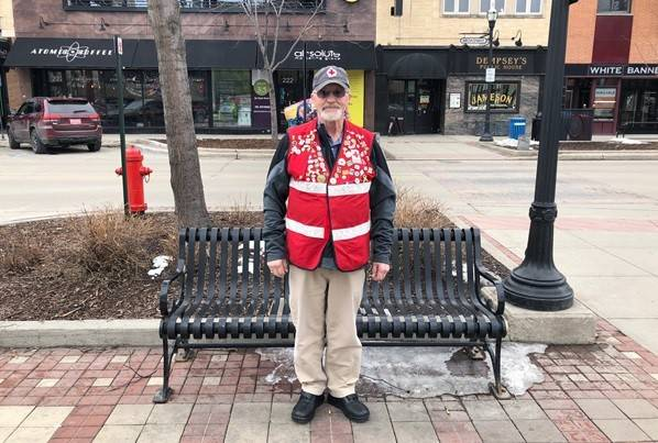 Jerry Walker stands in Downtown Fargo wearing his Red Cross vest.