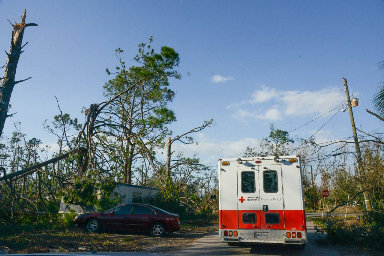 October 14, 2018, Panama City, Florida. American Red Cross emergency vehicles circulated in neighborhoods to provide hot meals, water, and snacks to residents who are still without electrical power or water service due to damage caused by Hurricane Michael. The food was prepared at a mobile kitchen operated by Southern Baptist Disaster Relief and delivered to residents, both in shelters and homes, by Red Cross workers. People receiving the meals repeatedly expressed their thanks in this city where most grocery stores and restaurants are still closed due to storm damage and lack of utility services. 