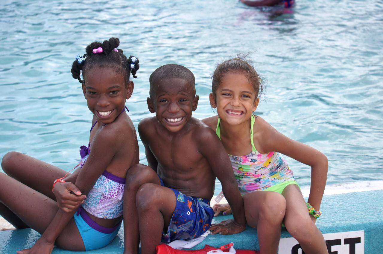 July 6, 2015. Brevard County Parks and Recreation, Florida. Ta'Mya Boyd, 8, Jeremiah Vildor, 6, and Brianna Deranleau  participate in swim lessons during summer camp as part of the Red Cross Centennial Campaign.  Photo by Connie Harvey/American Red Cross