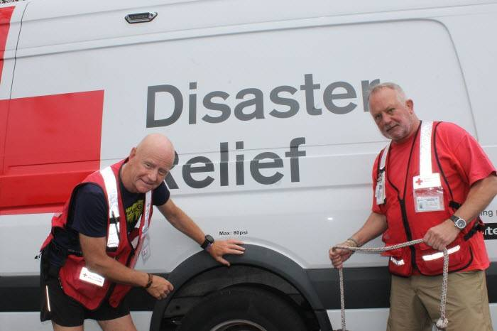 Red Cross volunteers, Federico Materazzi and Bryan Ward inspecting an emergency response vehicle.