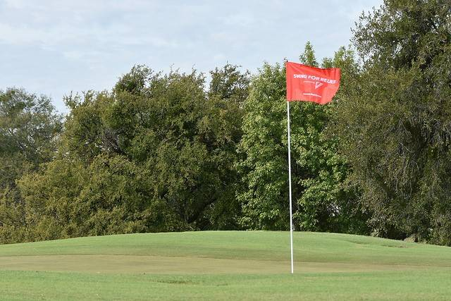 American Red Cross North Texas Swing for Relief Golf Tournament Flag on the Green