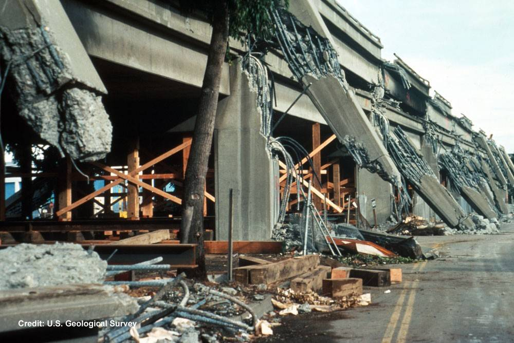 Support column failure and collapsed upper deck on the Cypress viaduct of Interstate 880.