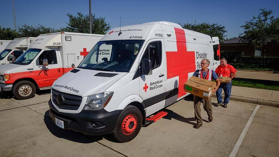 September 8, 2017. Sugar Land, Texas. Emergency Response Vehicle drivers Brett and Jim  loading for the lunch run from Kitchen 11 in Sugar Land, Texas. Photo by Chuck Haupt for the American Red Cross