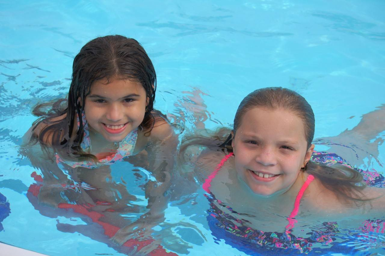 June 12, 2017. City of Haines City Parks and Recreation, Florida. Isobella and Alejandra learning to swim as part of the Aquatics Centennial Campaign. Photo by Connie Harvey/American Red Cross