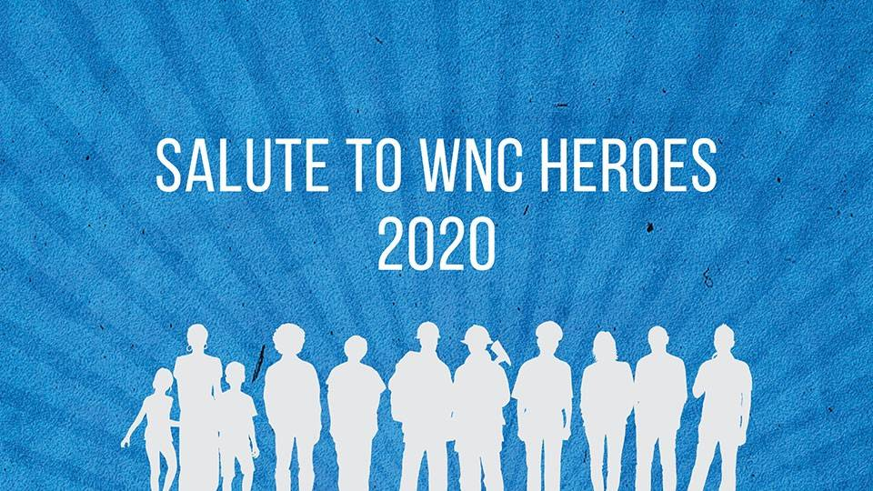 Blue banner advertising Salute to Heroes event with white silhouettes of people, firefighters and emergency responders