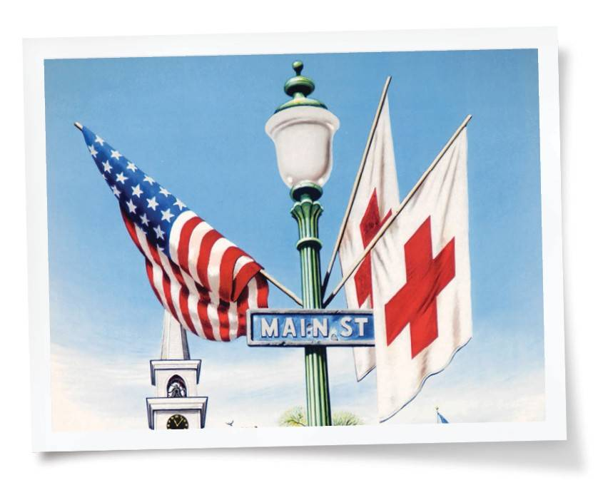 Heart of Tennessee Heroes event banner with an American flag, a Red Cross flag, and an Americana Main Street  Sign