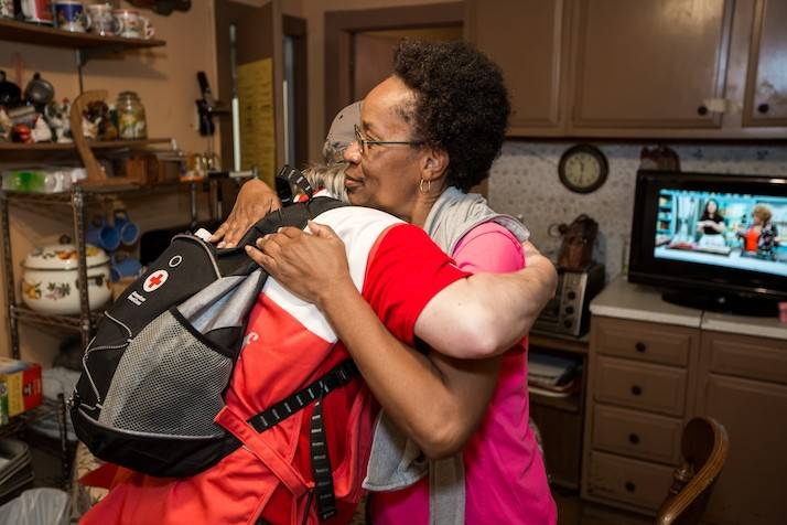 Woman hugs Red Cross volunteer