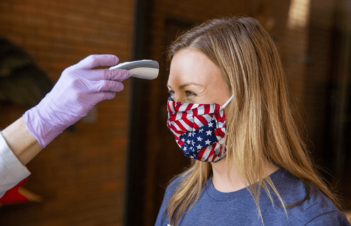 Woman getting her temperature taken