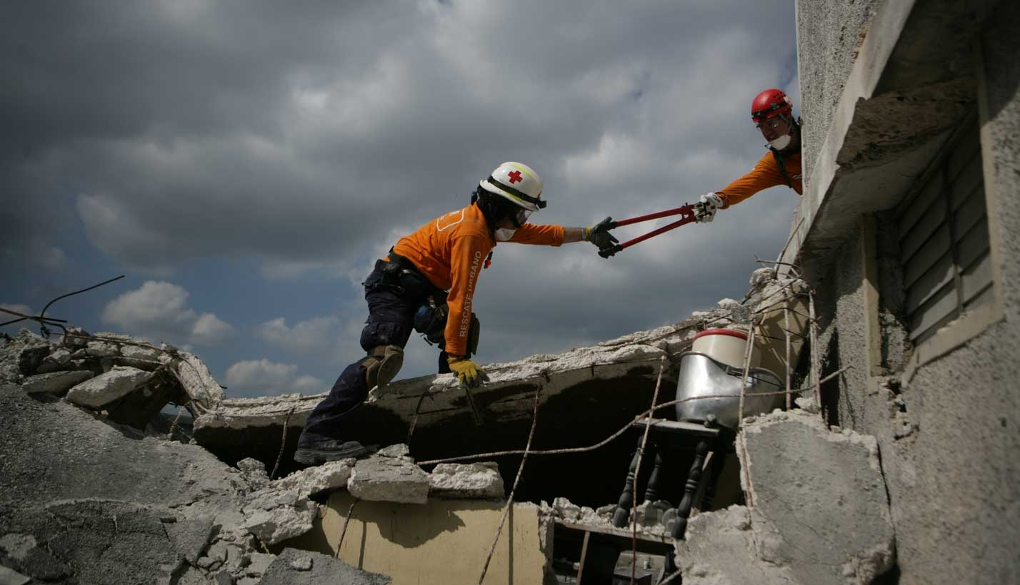 Workers conduct search and rescue efforts after earthquake