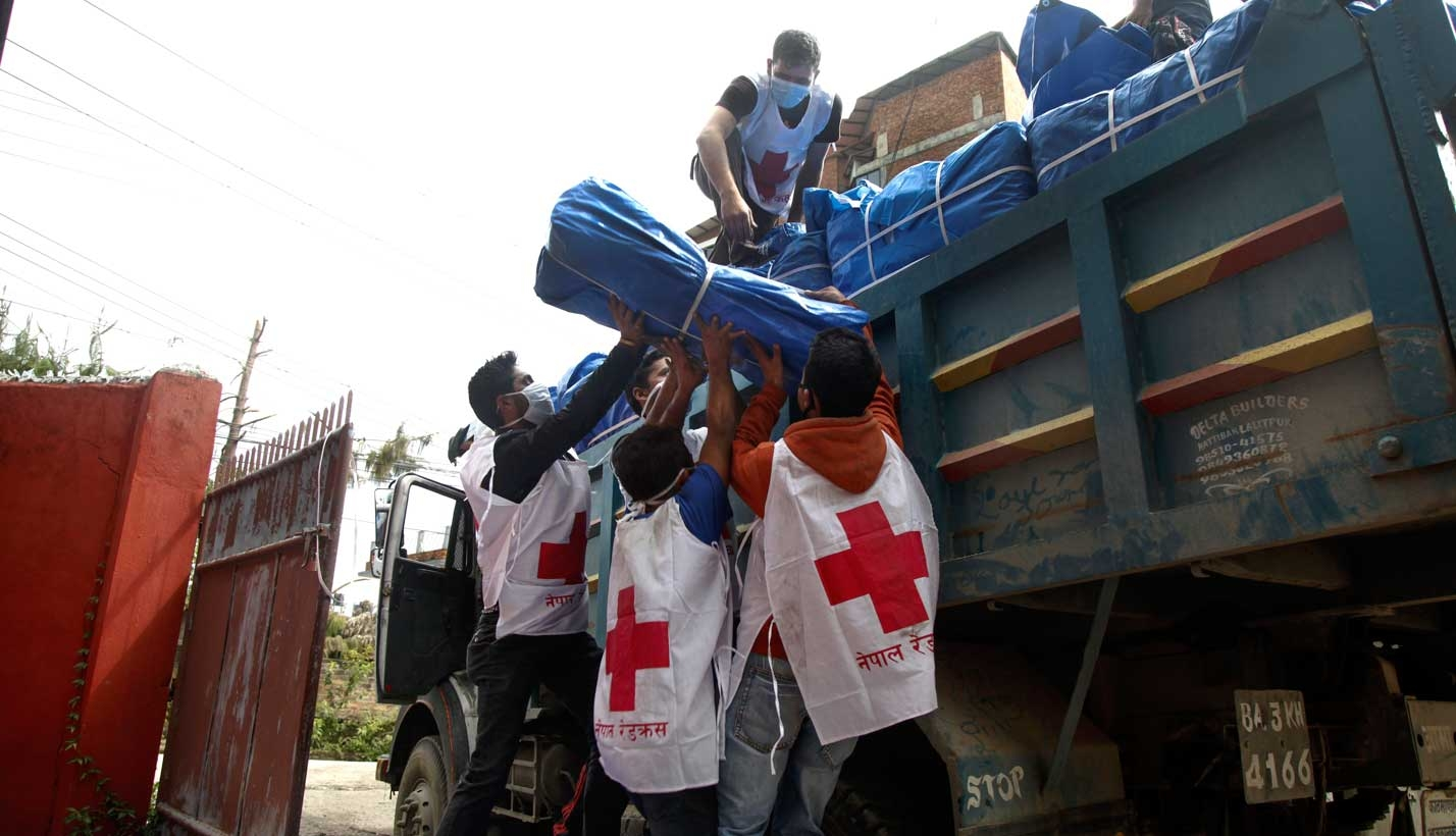 Workers unload supplies from truck