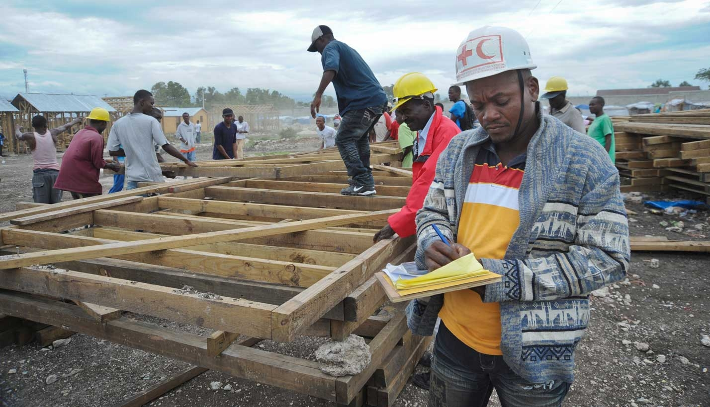 Workers in Haiti build temporary shelters