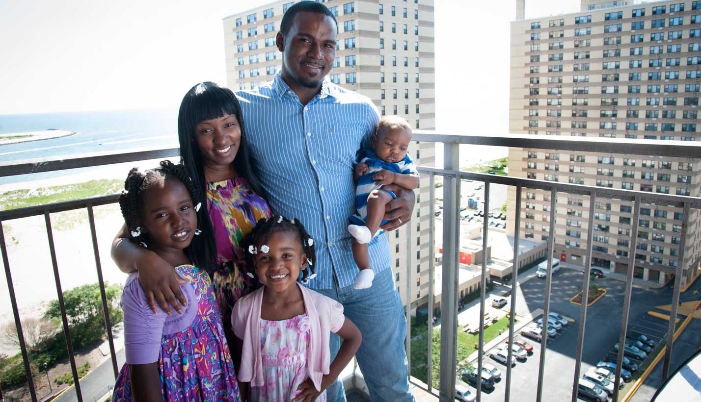 Family who lost home in Sandy poses in their new apartment
