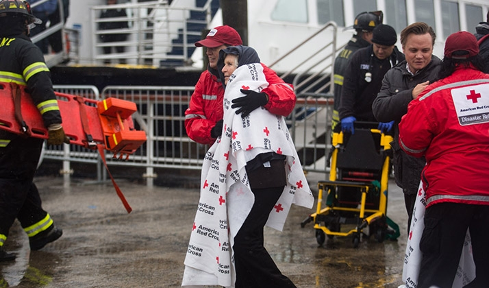 red cross helps passanger from plane