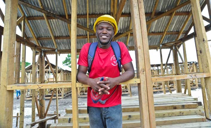 Man helps build shelter in Haiti