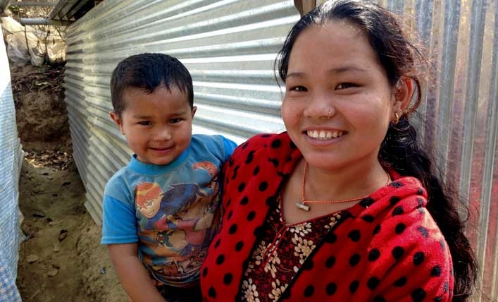 Mother in Nepal holds son