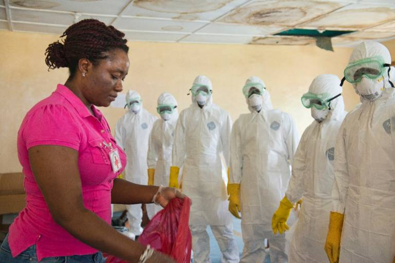 International-Services-Ebola-Africa-Woman-Hazmat-suits