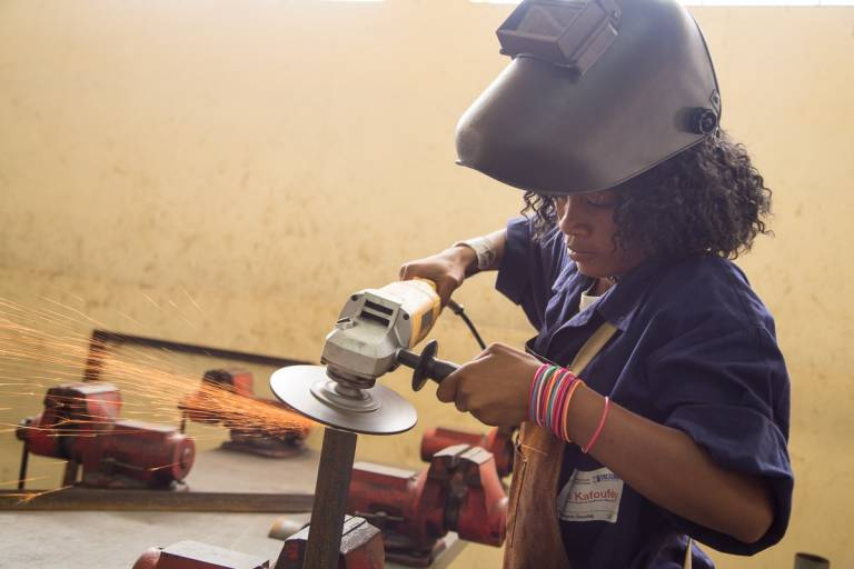 Robin Yevline practices metal work at a professional training center in Port-au-Prince, Haiti.
