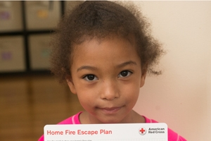 Girl holds up Home Fire Escape Plan