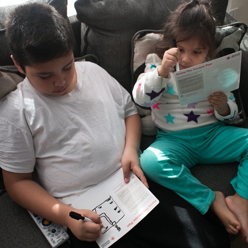 Kids fill out a home fire escape plan